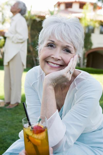 older woman at party | Dental Implants Doylestown PA