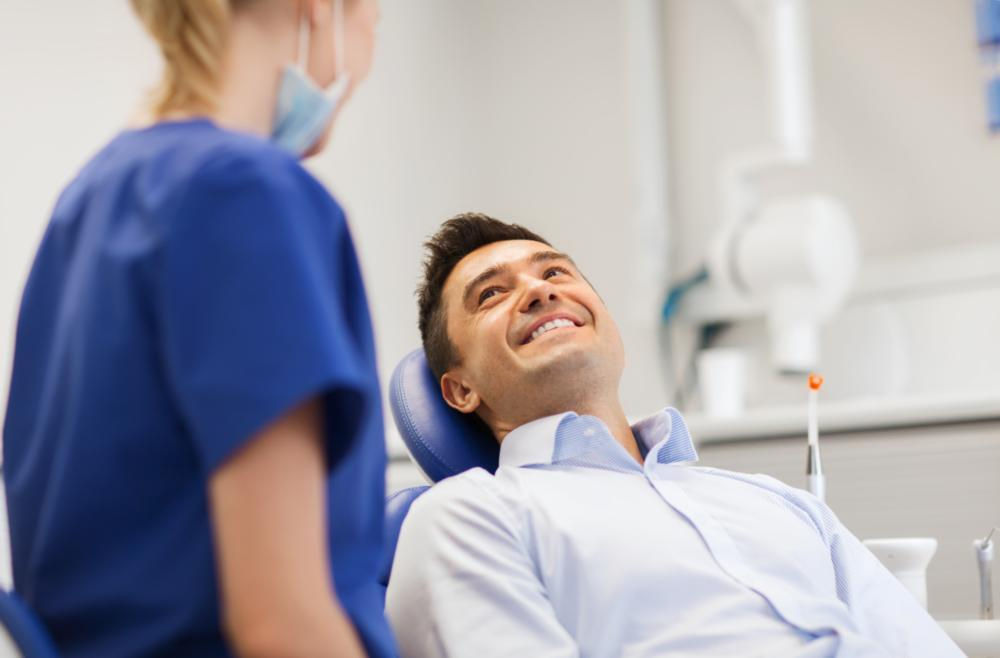 man laying in dental chair