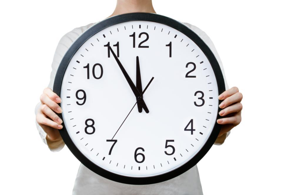image of someone holding up a clock | dentist doylestown