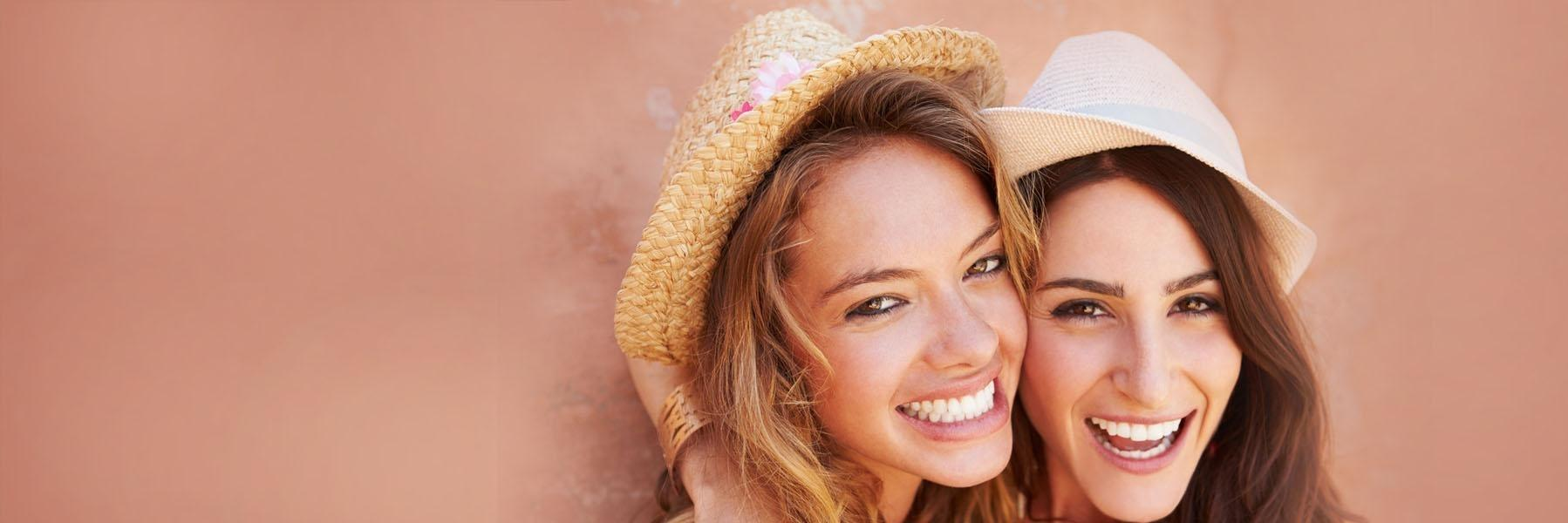 Two women laughing l Cosmetic Dentist Doylestown PA