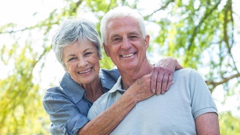 Smiling older couple | Implant-Supported Dentures in Doylestown PA | Doylestown Dental Group