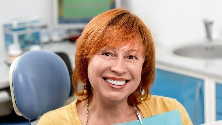 Smiling woman in dentist chair | Inlays and Onlays in Doylestown PA