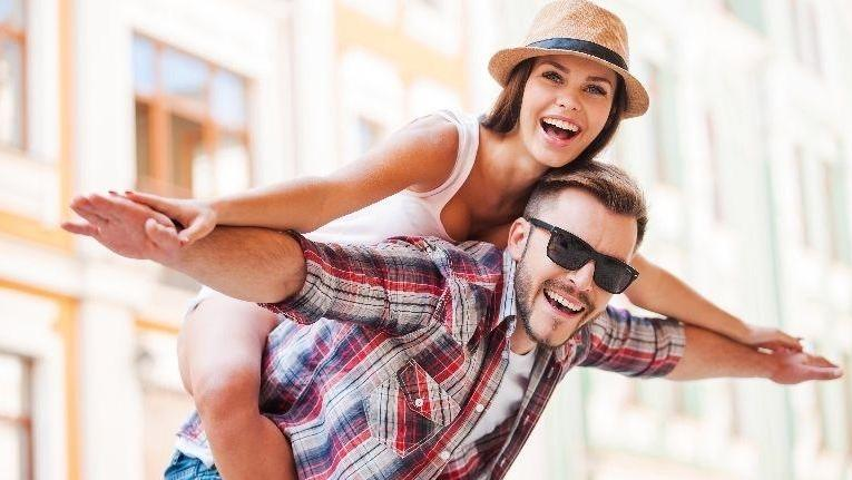 woman on man's back | Cosmetic Dentist Doylestown PA
