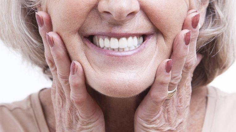 smiling woman | itchy gums | doylestown pa