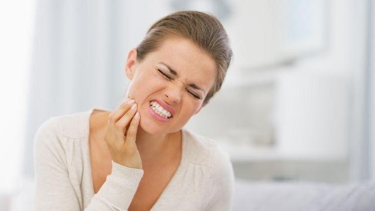 woman with tooth pain | Dentist in Doylestown PA
