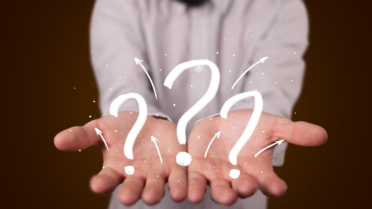 image of someone holding multiple question marks in their hands | dentist doylestown